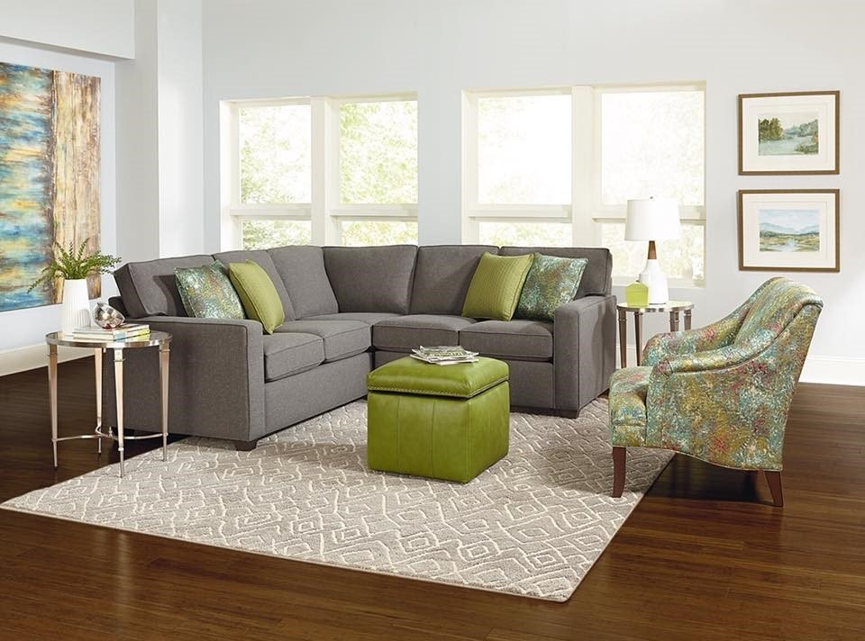 Chandler Sectional England Furniture with green pops of color throughout the living room